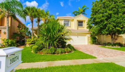Beautiful Waterfront Property with Large Pool in Boca Raton's Mission Bay Community